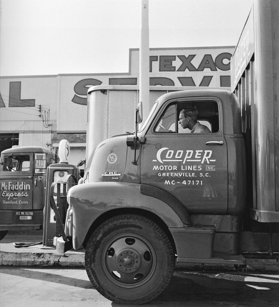 Cooper Motor Lines truck and driver at Texaco Service truck stop on U.S. 1, New Jersey, by Berenice Abbott.